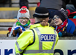 An officer from Police Scotland talks with young saints fans<br />
