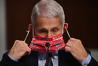 Dr. Anthony Fauci, director of the National Institute for Allergy and Infectious Diseases, lowers his face mask as he prepares to testify before the Senate Health, Education, Labor and Pensions (HELP) Committee on Capitol Hill in Washington DC on Tuesday, June 30, 2020.  Fauci and other government health officials updated the Senate on how to safely get back to school and the workplace during the COVID-19 pandemic. <br /> Credit: Kevin Dietsch / Pool via CNP /MediaPunch