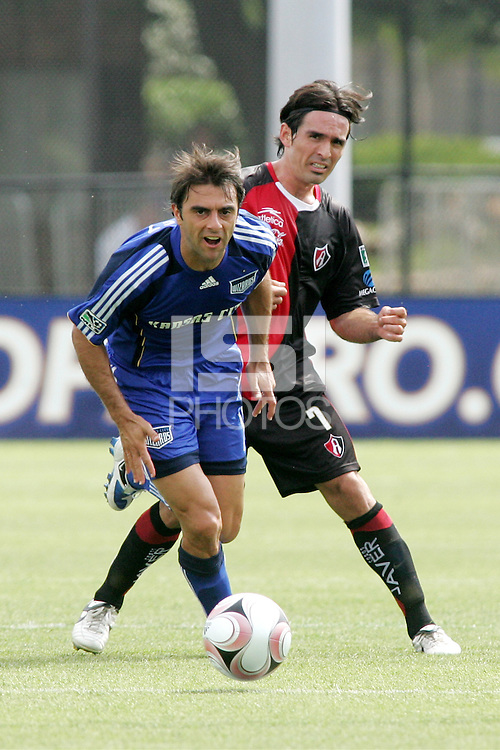 Claudio Lopez (blue), gets past Geraldo Espinoza..Kansas City Wizards and Atlas (Mexico) played to a 0-0 tie at Robert R Hermann Stadium, on the campus of Saint Louis University, St Louis , Missouri.