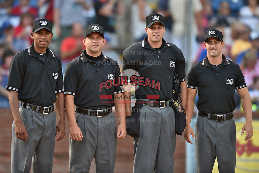 Umpires (L-R) Edwin Moscow, Jonathan Parra, Patrick Sharshel and Ben Sonntag before the South Atlantic League All Star Game on June 23, 2015 in Asheville, North Carolina. The North Division defeated the South 7-5(Tony Farlow/Four Seam Images)