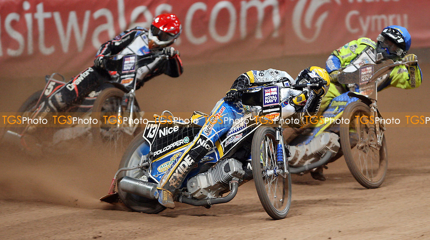 Heat 11: Jaroslaw Hampel (yellow), Andreas Jonsson (red) and Kenneth Bjerre (blue) - British Speedway Grand Prix at the Millennium Stadium, Cardiff - 10/07/10 - MANDATORY CREDIT: Rob Newell/TGSPHOTO - Self billing applies where appropriate - 0845 094 6026 - contact@tgsphoto.co.uk - NO UNPAID USE.