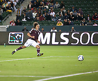 Colorado Rapid forward Quincy Amarikwa (12) shoots toward an open goal and begins to celebrate his goal during the first half of the game between Chivas USA and Colorado Rapids at the Home Depot Center in Carson, CA, on March 26, 2011. Final score Chivas USA 0, Colorado Rapids 1.