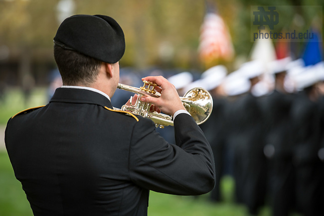 November 7, 2017; An Army ROTC cadet plays Taps at the annual Veterans Day ceremony. (Photo by Matt Cashore/University of Notre Dame)