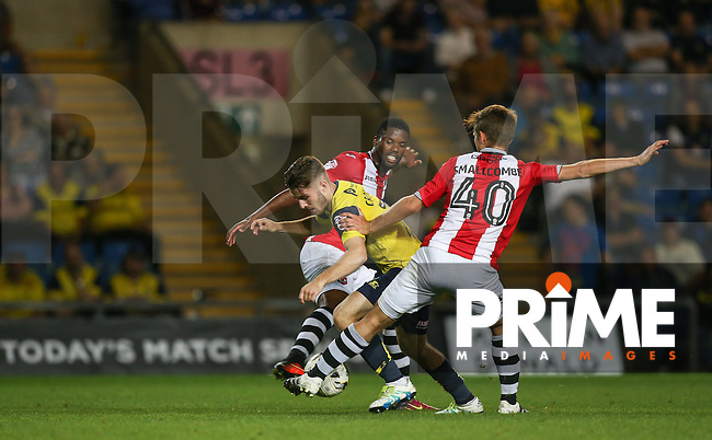 Max Smallcombe of Exeter City & Max Smallcombe (40) of Exeter City put an end to a Dan Crowley of Oxford United attack during the The Checkatrade Trophy match between Oxford United and Exeter City at the Kassam Stadium, Oxford, England on 30 August 2016. Photo by Andy Rowland / PRiME Media Images.
