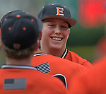 Edwardsville pitcher Matthew Boyer is all smiles as teammates run out to celebrate their victory over Belleville West with him after he threw a complete game. Edwardsville defeated Belleville West in a semifinal of the Class 4A Bloomington boys baseball sectional which was played in O'Fallon, IL on Wednesday May 29, 2019.<br />