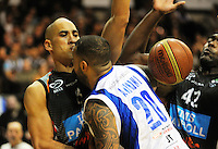Benny Anthony Jr loses the ball under pressure from Paora Winitana (left) and Kareem Johnson during the national basketball league final between Wellington Saints and Bay Hawks at TSB Bank Arena, Wellington, New Zealand on Saturday, 5 July 2014. Photo: Dave Lintott / lintottphoto.co.nz