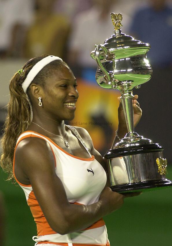 Australian Open Tennis 2003.25/01/2003.Serena Williams v Venus Williams  Final.Serena Williams holds the Womens singles trophy.
