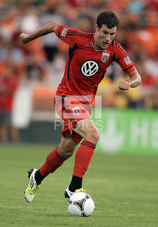 WASHINGTON, DC - July 28, 2012:  Chris Pontius (13) of DC United on the attack against PSG (Paris Saint-Germain) in an international friendly match at RFK Stadium in Washington DC on July 28. The game ended in a 1-1 tie.