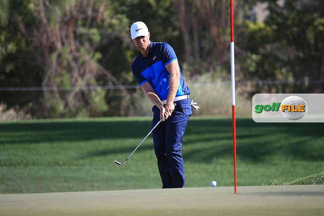 Lucas Bjerregaard (DEN) chips onto the 15th green during Round One of the 2016 Omega Dubai Desert Classic, played on the Emirates Golf Club, Dubai, United Arab Emirates.  04/02/2016. Picture: Golffile | David Lloyd<br /> <br /> All photos usage must carry mandatory copyright credit (&copy; Golffile | David Lloyd)