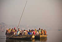 Boats packed with early morning pilgrims make their way through the mist and smoke along the Ganges. (Photo by Matt Considine - Images of Asia Collection)