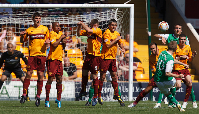 Derek Riordan floats a free-kick over the Motherwell defensive wall