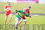 Kerry's Tommy Barrett reaches for the ball before Derry's Brendan Rodgers at Austin Stack park, Tralee on Sunday.