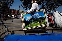 ISTANBUL - MAY 28, 2007:  A man crosses the street carrying a painting in  Istanbul, Turkey. Photo by Landon Nordeman.