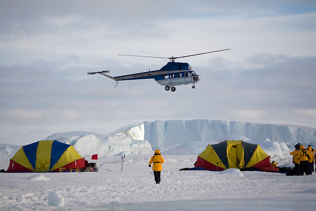 Russian Mi-2 helicopter by the safety tents at Snow Hill Island. Antarctica
