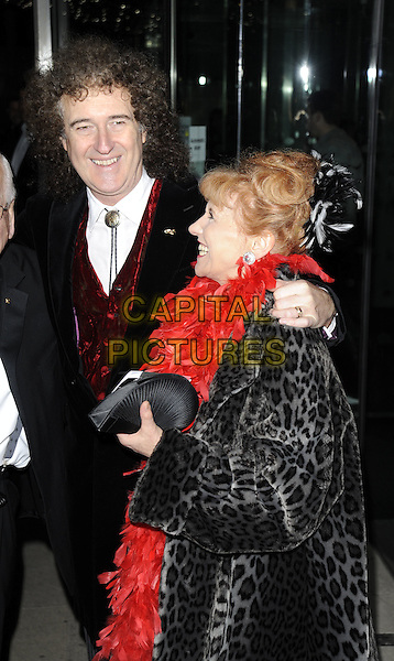 BRIAN MAY & ANITA DOBSON.At the Variety Club Annual Dinner & Ball, London Hilton Hotel, Park Lane, London, England, UK, March 13th 2010..half length red feather boa smiling married couple husband wife  waistcoat arm around tie grey gray black leopard animal fur print coat side profile clutch bag .CAP/CAN.©Can Nguyen/Capital Pictures