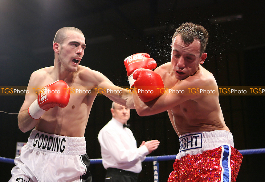 Rick Godding (Bolton, white shorts) defeats Kristian Laight (Nuneaton, red shorts) in a welterweight contest at.Robin Park Centre, Wigan promoted by Frank Maloney - 06/03/09 - .MANDATORY CREDIT: Chris Royle/TGSPHOTO - Self billing applies where appropriate - Tel: 0845 094 6026.