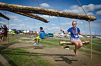 Scouts trying out a whirlygig completely made of wood and driven by manual power. Photo: Malin Duveblad/Scouterna