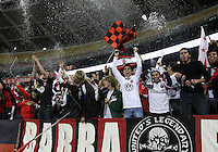 WASHINGTON, DC - OCTOBER 20, 2012:  Beer shower from fans of D.C United at the win over the Columbus Crew during an MLS match at RFK Stadium in Washington D.C. on October 20. D.C United won 3-2.