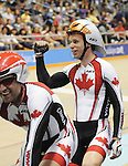 November 15 2011 - Guadalajara, Mexico:  Daniel Chalifour with his pilot Ed Veal after winning gold in the Men's Pursuit Final competing in the Men's C1-C5 1k in the Panamerican Velodrome at the 2011 Parapan American Games in Guadalajara, Mexico.  Photos: Matthew Murnaghan/Canadian Paralympic Committee
