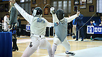 11 February 2017: Duke's Jan Maceczek (right) scores a hit on MIT's Arjen Gupta (left) in Foil. The Duke University Blue Devils hosted the Massachusetts Institute of Technology Engineers at Card Gym in Durham, North Carolina in a 2017 College Men's Fencing match. Duke won the dual match 19-8 overall, 7-2 Foil, 6-3 Epee, and 6-3 Saber.