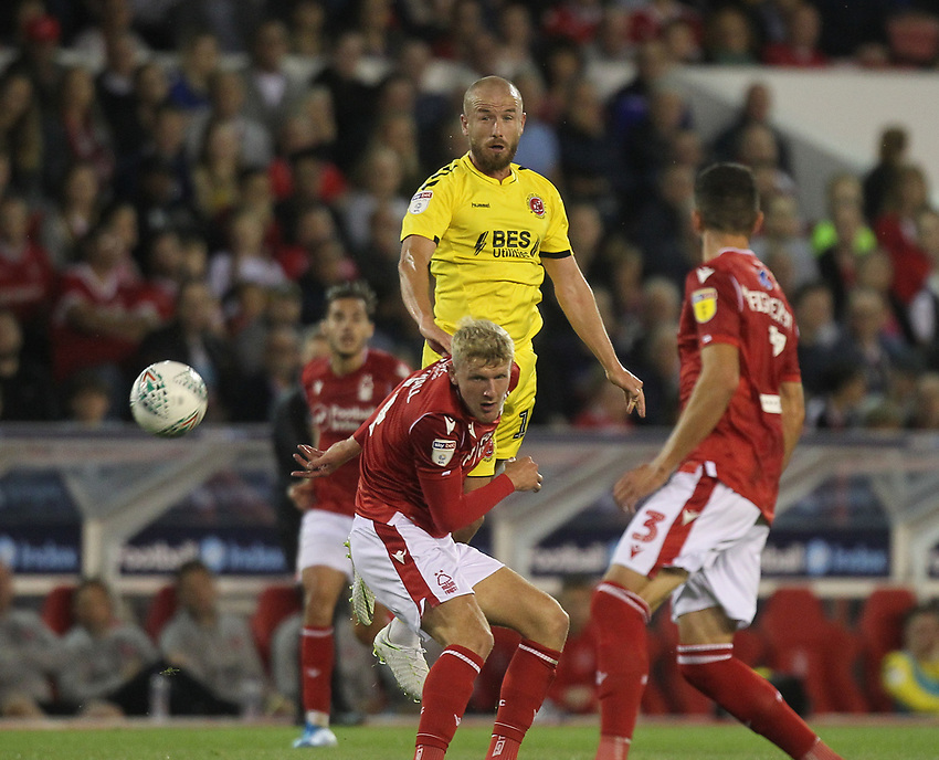 Fleetwood Town's Paddy Madden  gets a header on goal<br /> <br /> Photographer Mick Walker/CameraSport<br /> <br /> The Carabao Cup First Round - Nottingham Forest v Fleetwood Town - Tuesday 13th August 2019 - The City Ground - Nottingham<br />  <br /> World Copyright © 2019 CameraSport. All rights reserved. 43 Linden Ave. Countesthorpe. Leicester. England. LE8 5PG - Tel: +44 (0) 116 277 4147 - admin@camerasport.com - www.camerasport.com