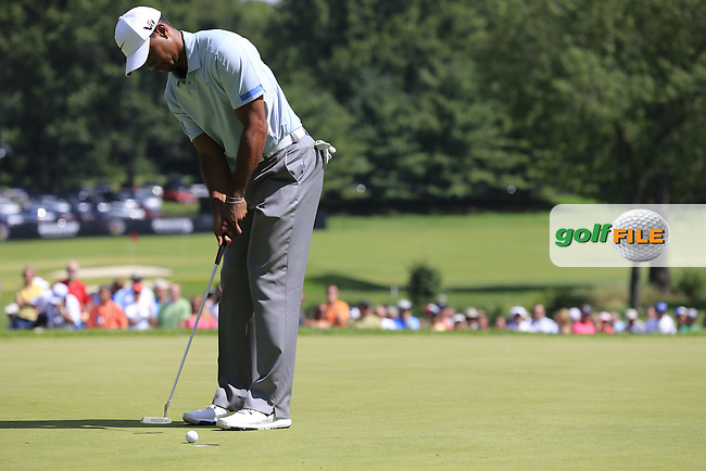 Tiger Woods (USA) putts on the 9th green during Saturday's Round 3 of the 2013 Bridgestone Invitational WGC tournament held at the Firestone Country Club, Akron, Ohio. 3rd August 2013.<br /> Picture: Eoin Clarke www.golffile.ie