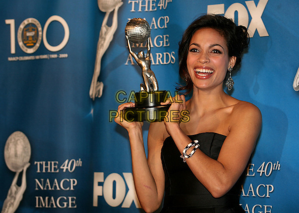 ROSARIO DAWSON.40th Annual NAACP Image Awards - Press Room at the Shrine Auditorium, Los Angeles, California, USA..February 12th, 2009.half length award trophy black strapless dangling silver earrings bracelet dress.CAP/ADM/BP.©Byron Purvis/AdMedia/Capital Pictures.