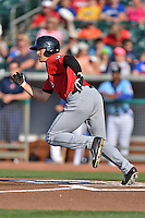Birmingham Barons left fielder Trayce Thompson #21 runs to first during a game against the Tennessee Smokies at Smokies Park on May 31, 2014 in , Tennessee. The Barons defeated the Smokies 2-1. (Tony Farlow/Four Seam Images)