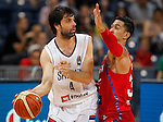 BELGRADE, SERBIA - JULY 04: Milos Teodosic (L) of Serbia in action against David Huertas (R) of Puerto Rico during the 2016 FIBA World Olympic Qualifying basketball Group A match between Serbia and Puerto Rico at Kombank Arena on July 04, 2016 in Belgrade, Serbia. (Photo by Srdjan Stevanovic/Getty Images)