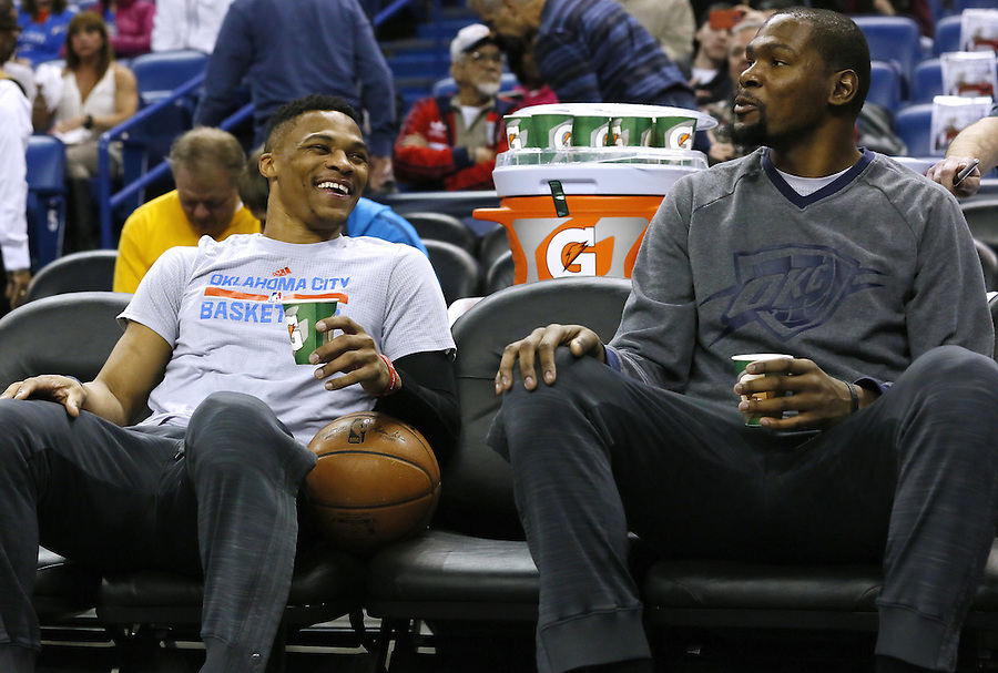 Oklahoma City Thunder guard Russell Westbrook, left, and forward Kevin Durant react before an NBA basketball game Thursday, Feb. 25, 2016, in New Orleans. (AP Photo/Jonathan Bachman)