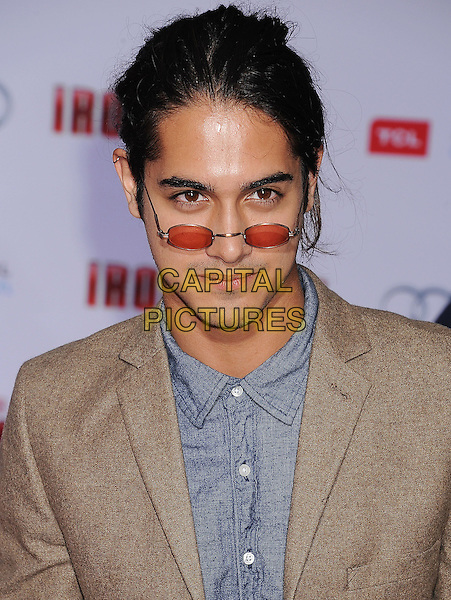 "Avan Jogia.The Los Angeles Premiere of ""Iron Man 3"" at El Capitan Theatre in Hollywood, California, USA..April 24th, 2013.headshot portrait red tinted sunglasses shades blue shirt brown.CAP/ROT/TM.©Tony Michaels/Roth Stock/Capital Pictures"