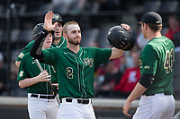 Johnny Aiello (2) of the Wake Forest Demon Deacons is greeted by teammates after scoring a run against the Louisville Cardinals at David F. Couch Ballpark on March 17, 2018 in  Winston-Salem, North Carolina.  The Cardinals defeated the Demon Deacons 11-6.  (Brian Westerholt/Four Seam Images)