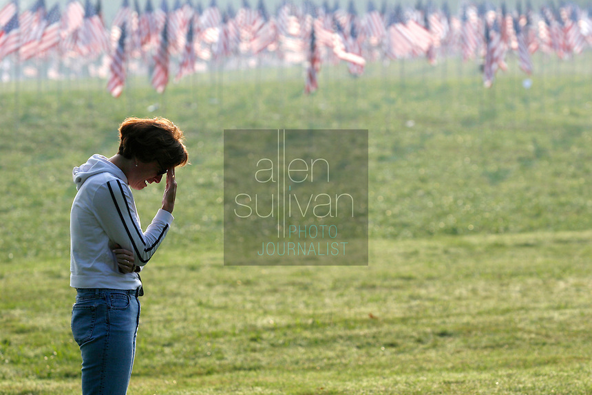 Victoria S. Aronow cries at Kennesaw Mountain National Battlefield Park during a reading of the names of people who died in the terrorist attacks of five years ago. Aronow's cousin, Richard Avery Aronow, died in the World Trade Center's north tower, she said. The Kiwanis Club of Marietta placed 2,996 flags in the park in remembrance.