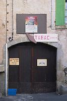 Tabac tobacco shop, Chateau Petit Alain, La cave a vin, the wine cellar. La Liquiere village. Faugeres. Languedoc. A door. France. Europe.