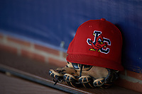 A Johnson City Cardinals hat rests on a glove in the dugout during a game against the Danville Braves on July 29, 2018 at TVA Credit Union Ballpark in Johnson City, Tennessee.  Johnson City defeated Danville 8-1.  (Mike Janes/Four Seam Images)
