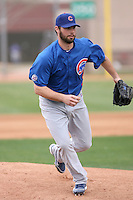 Randy Wells #36 of the Chicago Cubs participates in pitchers fielding practice during spring training workouts at the Cubs complex on February 19, 2011  in Mesa, Arizona. .Photo by Bill Mitchell / Four Seam Images.