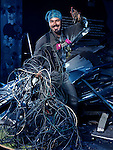 Smiling eletrical contractor with a bunch of wires artistic portrait