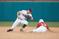 Brock Deatherage (13) of the North Carolina State Wolfpack steals second base ahead of the tag from Army Black Knights shortstop Trey Martin (6) at Doak Field at Dail Park on June 3, 2018 in Raleigh, North Carolina. The Wolfpack defeated the Black Knights 11-1. (Brian Westerholt/Four Seam Images)