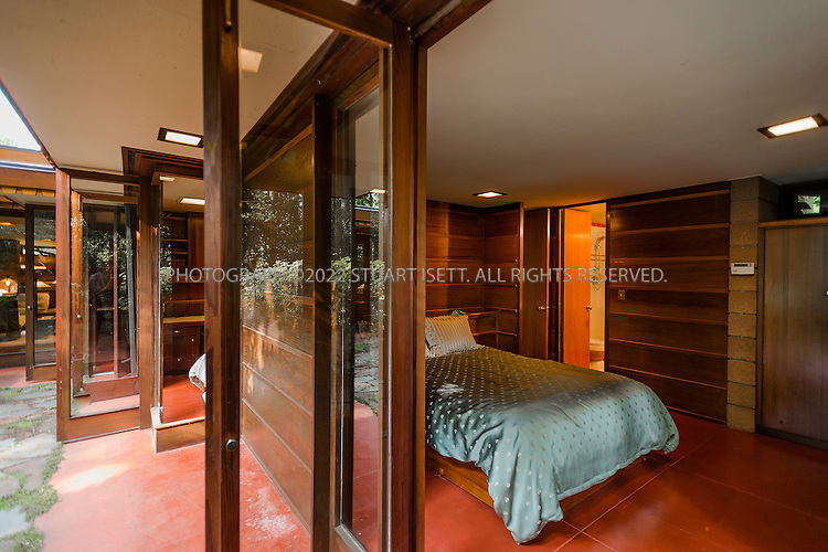 """10/9/2012--Sammamish, WA, USA..VIEW: Exterior view showing master bedroom (right) and living room (back left)...Architect Frank Lloyd Wright planned his """"Usonian"""" homes to be affordable for middle-class families. The 1,950 square foot Brandes home is for sale in Sammamish, Washington (30 minutes from Seattle) at $1.39 million. It features three bedrooms, two bathrooms and a small, separate office/study space...The home was built in 1952, and has redwood trim and Wright's original furniture and some garden sculptures by Wright. It's one of only three Frank Lloyd Wright homes near Seattle...©2012 Stuart Isett. All rights reserved."""