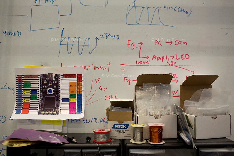 Diagrams and equations fill a whiteboard wall in the Camera Culture group space at MIT's Media Lab in Cambridge, Massachusetts, USA.