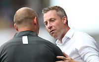 Millwall manager Neil Harris and Preston North End manager Alex Neil <br /> <br /> Photographer Rob Newell/CameraSport<br /> <br /> The EFL Sky Bet Championship - Millwall v Preston North End - Saturday 3rd August 2019 - The Den - London<br /> <br /> World Copyright © 2019 CameraSport. All rights reserved. 43 Linden Ave. Countesthorpe. Leicester. England. LE8 5PG - Tel: +44 (0) 116 277 4147 - admin@camerasport.com - www.camerasport.com