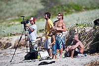 A cameraman, with GREG BROWNING (USA),  JAY OCCHILUPO (AUS), MARK OCCHILUPO (AUS) and  SHANE DORIAN (HAW) Surfing at DURANBAH BEACH, Australia ,   Photo: joliphotos.com