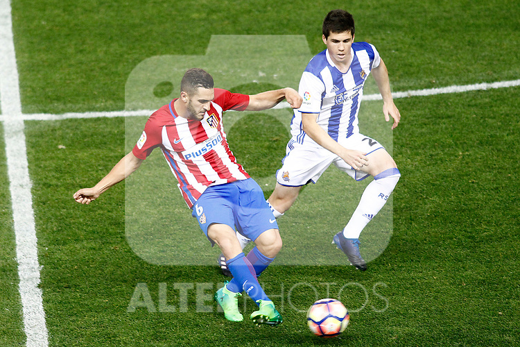 Atletico de Madrid's Koke Resurrecccion (l) and Real Sociedad's Igor Zubeldia during La Liga match. April 4,2017. (ALTERPHOTOS/Acero)