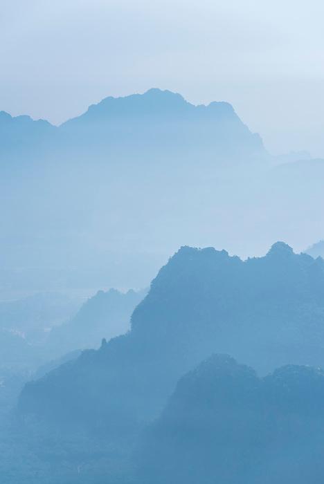 Misty limestone karst mountain landscape at sunrise, seen from Mount Zwegabin, Hpa An, Kayin State (Karen State), Myanmar (Burma)