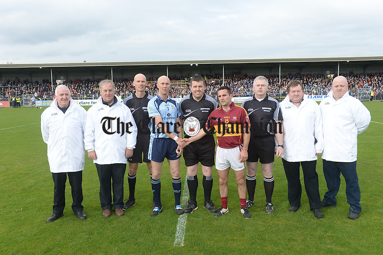Captains Conor Marrinan of Cooraclare and Brian Curtin of Miltown with match officials before the county senior football final at Cusack park. Photograph by John Kelly.
