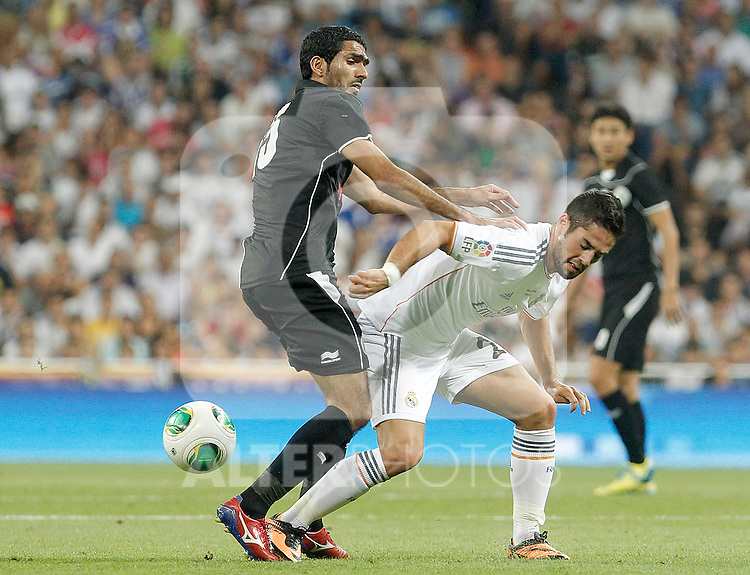 Real Madrid's Isco (r) and Al Sadd's Talal Ali Albloushiduring Santiago Bernabeu Trophy.August 22,2013. (ALTERPHOTOS/Acero)