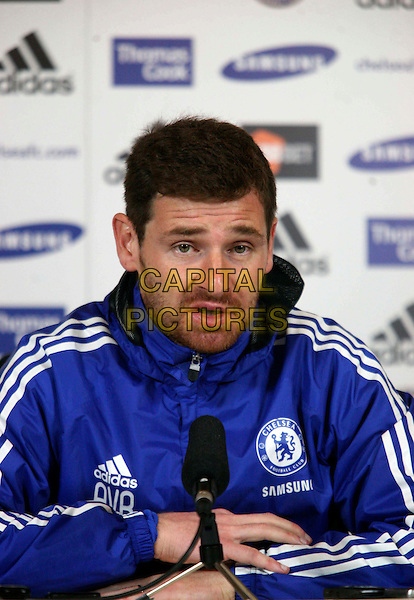 Andre Villas-Boas.Media conference to preview Norwich v Chelsea at Chelsea FC Training Ground, England..19th January 2012.headshot portrait blue jacket stubble facial hair half length microphone looks sad upset mouth open.CAP/DS.©Dudley Smith/Capital Pictures