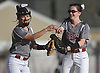 Toniann Servider #7, Clarke shortstop, left, gets congratulated by second baseman Kayla Connolly #4 after recording an out due to a Division Avenue baserunning gaffe in the top of the fifth inning of a Nassau County Conference ABC-II varsity softball game at Clarke High School on Thursday, April 26, 2018. Clarke won by a score of 4-2.