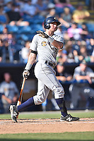 Charleston RiverDogs center fielder Austin Aune (22) swings at a pitch during a game against the Asheville Tourists on June 13, 2015 in Asheville, North Carolina. The Tourists defeated the RiverDogs 10-6. (Tony Farlow/Four Seam Images)