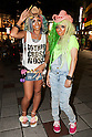 (L to R) Erimokkori of the Ganguro Cafe &amp; Bar with a female customer who has been transformed into a ganguro girl pose of pictures in the Shibuya shopping area on September 4, 2015. <br /> <br /> Ganguro is an alternative Japanese fashion trend which started in the mid-1990s where young women, rebelling against the traditional idea of Japanese beauty, wore colorful make-up and clothes and had dark-skin.<br /> <br /> 10 Ganguro fashion girls work in the new bar, which offers original Ganguro Balls (fried takoyaki style sausage balls in black squid ink batter) on its menu. Ganguro Caf&eacute; &amp; Bar also offers special services such as Ganguro make-up and the chance to take purikura (photo booth pictures) with staff and to look like a Ganguro girl walking around the Shibuya streets.<br /> <br /> The bar is popular with both Japanese and foreigners and has menus translated in English. (Photo by Rodrigo Reyes Marin/AFLO)